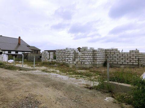 Земельный участок в д. Узигонты 10.55 соток ИЖС с фундаментом, .
