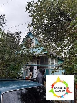 Брусовый дом на территории Садового товарищества «Труд» в Икше