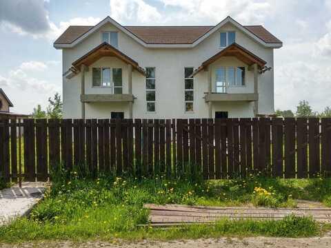 Надежный дом для двух семей, рядом с инфраструктурой.