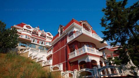 Продается четырехэтажный дом на набережной Алушты