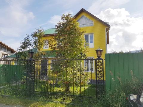 Дом в центре города с двумя гаражами