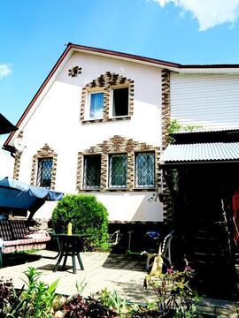 Кирпичный дом 140 кв.м. на ухоженном, зеленом участке 15 соток.