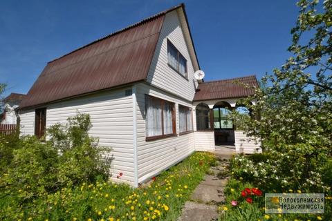 Бревенчатый дачный дом с земельным участком в СНТ «Ветеран»