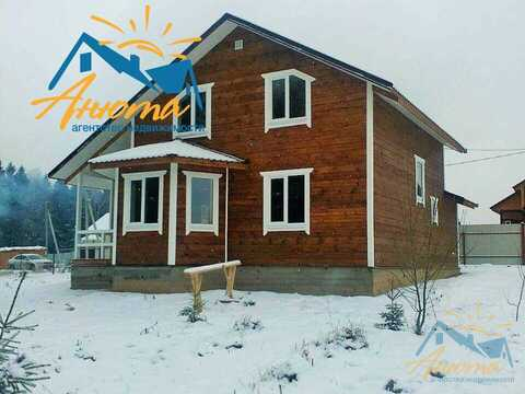Новый дом на при лесном участке на берегу озера