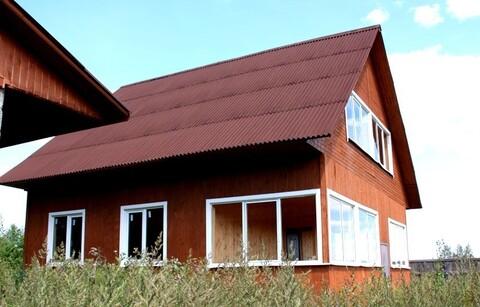 Брусовый дом с гаражом в деревне.