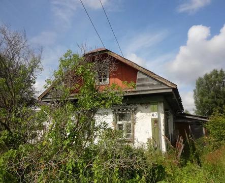 Дом бревенчатый в Большесельском районе. село Дунилово.