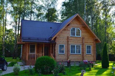 Обжитой дом на удивительном участке с лесными деревьями и ландшафтным