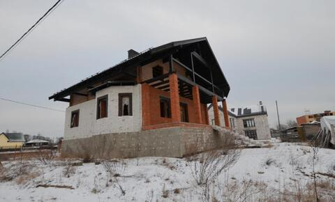 Новый дом в стиле шале из клееного бруса на кирпиче в черте города .