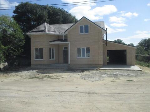 Дом в 2 этажа с центральной водой, гаражом и большим земельным участком