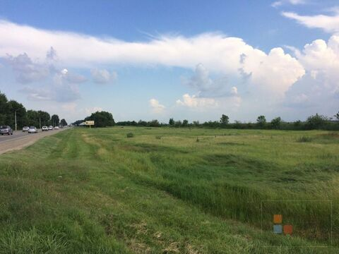 Продаю земельный участок под коммерцию вдоль трассы .