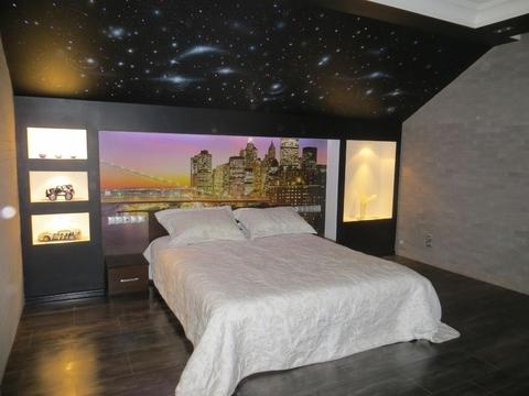 Большой уютный четырехуровневый коттедж с дизайнерской отделкой в г. .