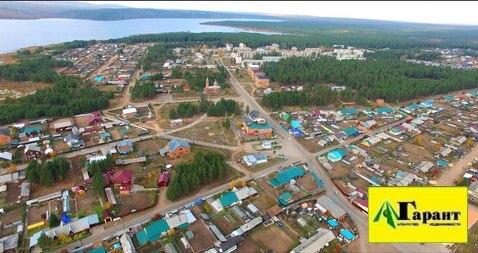 Продается земельный участок 55 сот. в Иркутсой обл. пгт. Новая Игирм