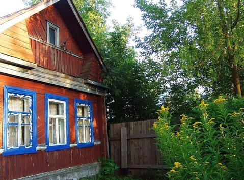 Бревенчатый дом на реке Нерль в селе Кибергино