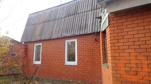 Деревянный жилой дом, обложен кирпичем пл.49.3 на участке в 12 соток в .