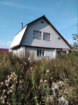 Бревенчатый дом с мансардой 65.6 кв.м. с земельным участком 25 соток .